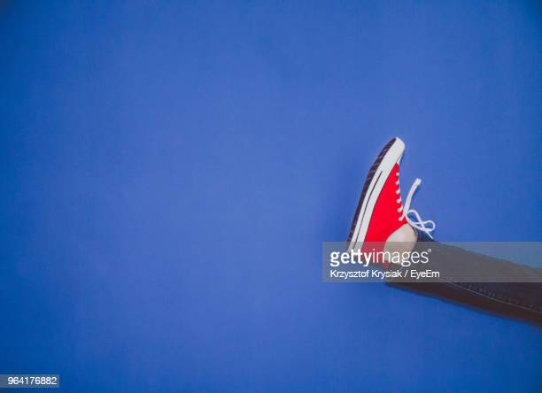low section of red shoes against clear blue sky - blue shoe stock pictures, royalty-free photos & images
