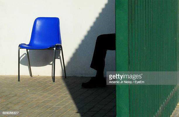 Low Section Of Security Guard Sitting Near Gate