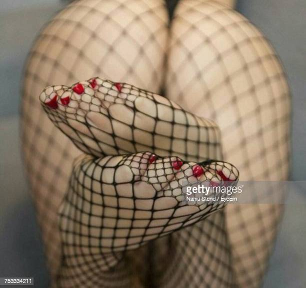 low section of seductive fashion model wearing fishnet stockings - nylon feet stock photos and pictures