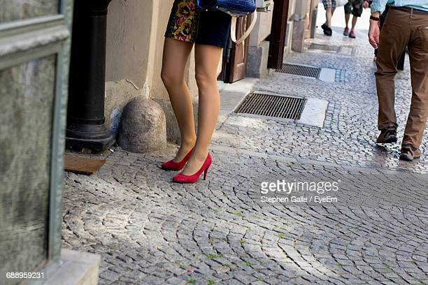 Low Section Of Sensuous Woman Standing On Footpath