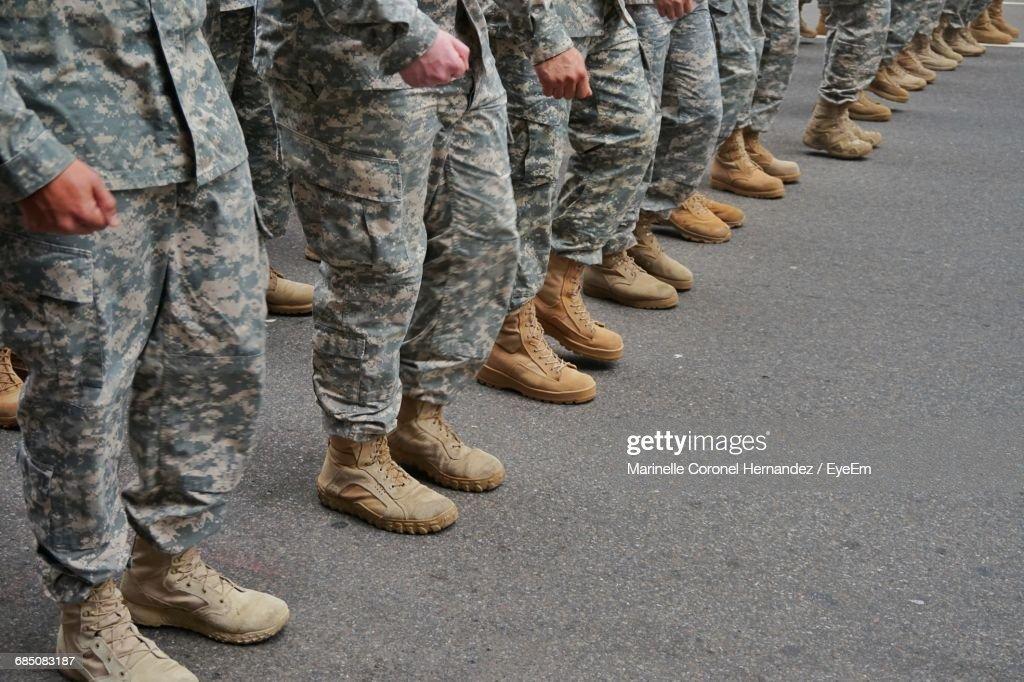Low Section Of Soldiers Standing In A Row : Stock Photo