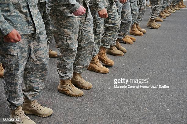 low section of soldiers standing in a row - personale militare foto e immagini stock