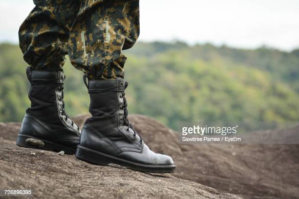 Low Section Of Solider Standing On Rock
