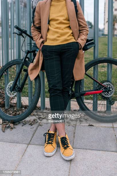 low section of stylish young man with bicycle in the city - hands in pockets stock pictures, royalty-free photos & images