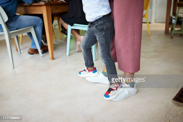 low section of teenage girl carrying boy on foot - simple living stock pictures, royalty-free photos & images