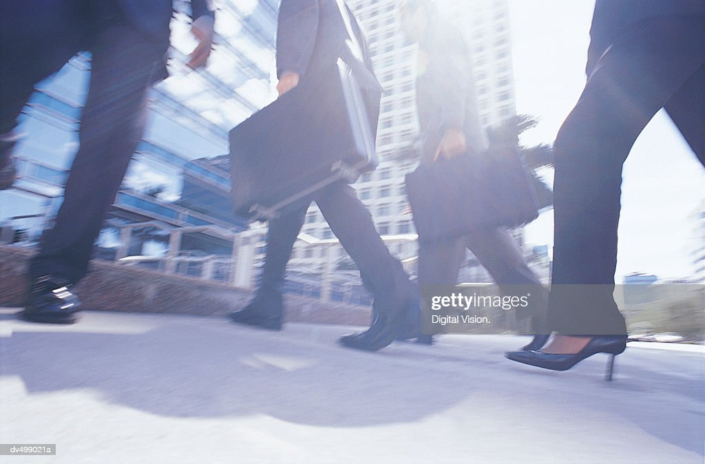 Low Section of Walking Business People : Stock Photo