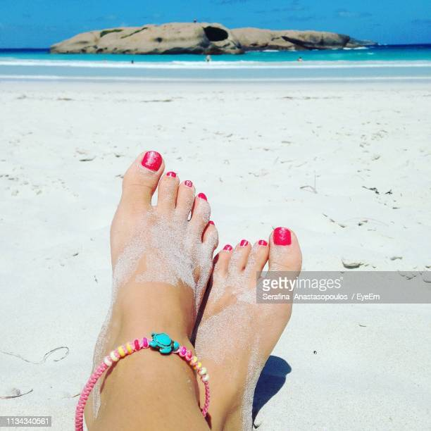 low section of woman at beach during summer - toe stock pictures, royalty-free photos & images