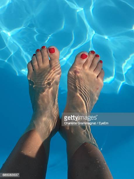 Low Section Of Woman Deep In Swimming Pool
