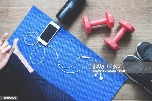 low section of woman exercising on exercise mat - home workout stock pictures, royalty-free photos & images