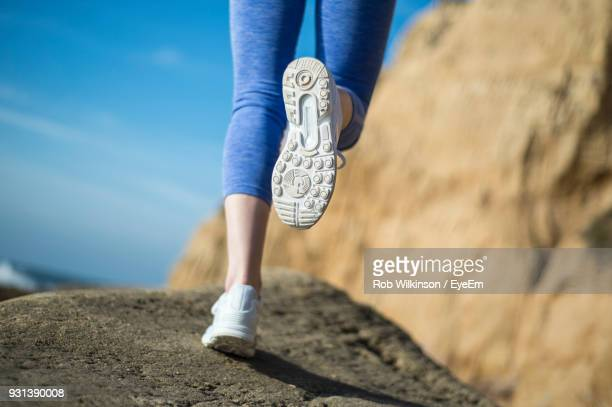 Low Section Of Woman Exercising On Rock