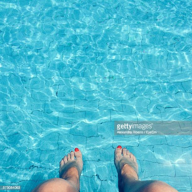 Low Section Of Woman Feet Underwater In Pool