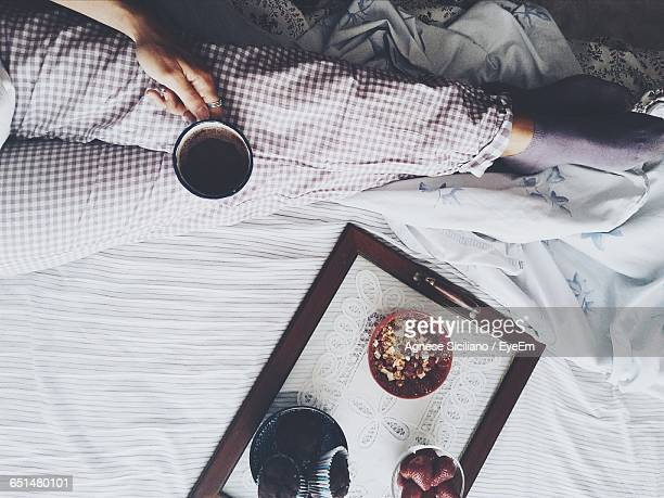 Low Section Of Woman Having Breakfast On Bed