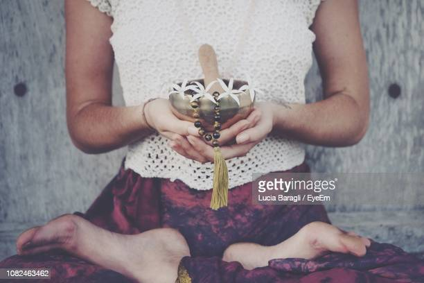 low section of woman holding flowers and bead necklace in rin gong - gong stock pictures, royalty-free photos & images