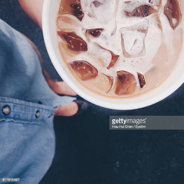 Low Section Of Woman Holding Iced Coffee