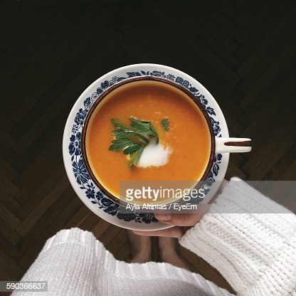 Low Section Of Woman Holding Soup