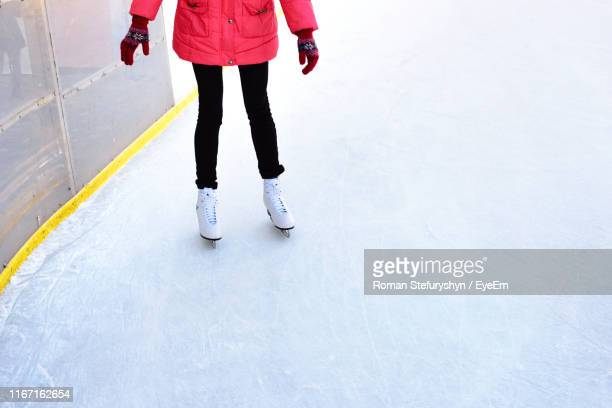 low section of woman ice-skating on snow - ice rink stock pictures, royalty-free photos & images