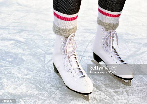 low section of woman ice-skating - ice skate stock pictures, royalty-free photos & images