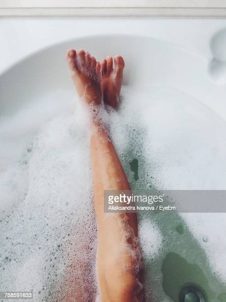 low section of woman in bathtub - taking a bath stock pictures, royalty-free photos & images