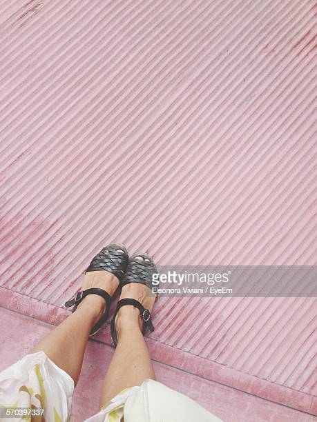 low section of woman in black sandal - sandal stock pictures, royalty-free photos & images