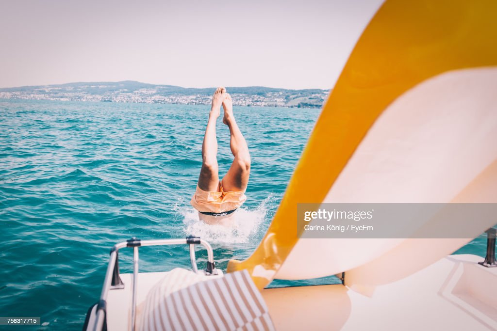 Low Section Of Woman In Boat Sailing On Sea Against Clear Sky : Stock Photo
