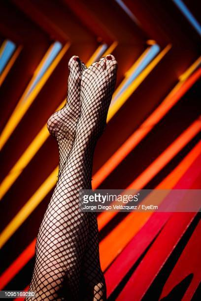 low section of woman in fishnet stockings - fishnet stockings stock pictures, royalty-free photos & images