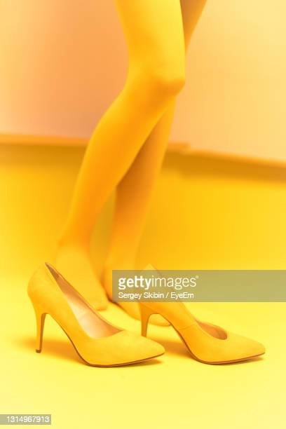 low section of woman in high heels - high heels stock pictures, royalty-free photos & images
