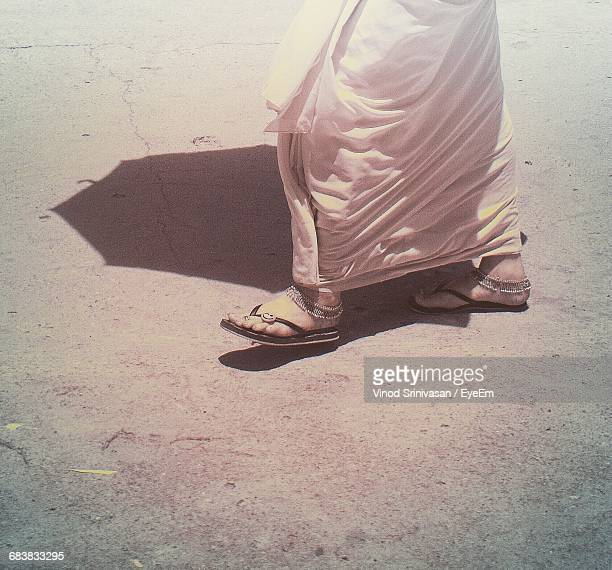 Low Section Of Woman In Sari Walking On Footpath