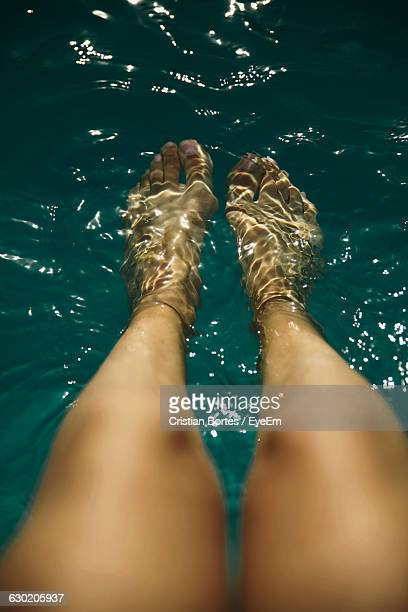 low section of woman in sea - bortes stock pictures, royalty-free photos & images