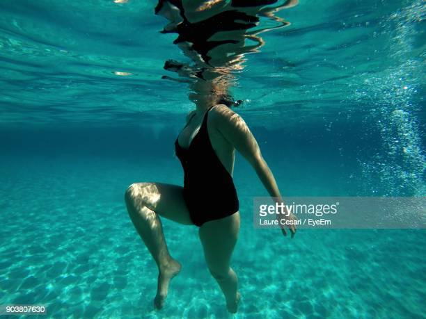 Low Section Of Woman In Sea