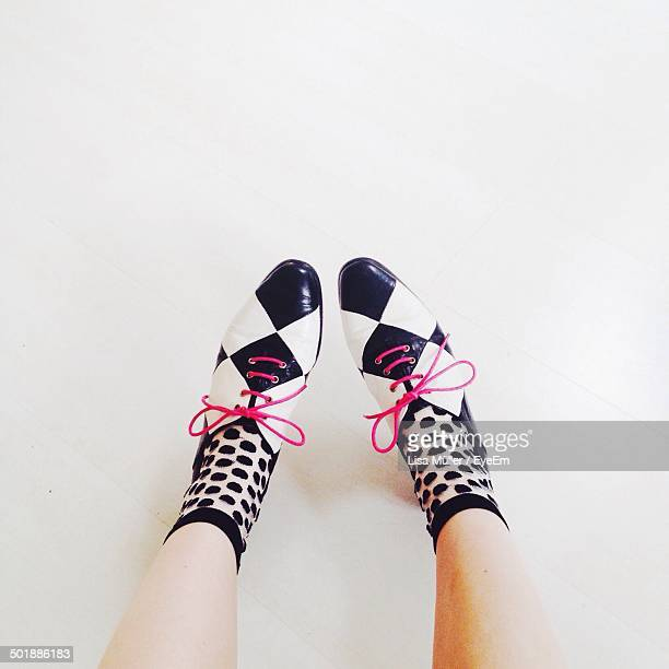 Low section of woman in shoes and socks