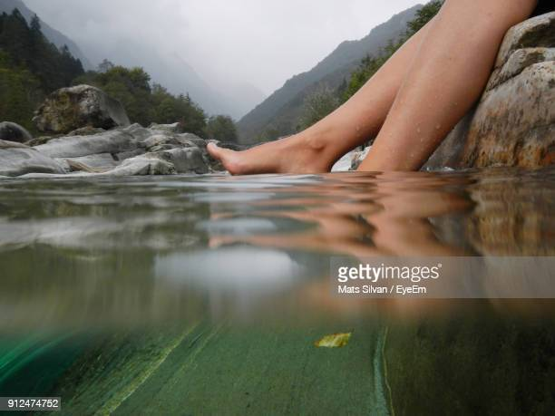 low section of woman in water - mujeres fotos stock pictures, royalty-free photos & images