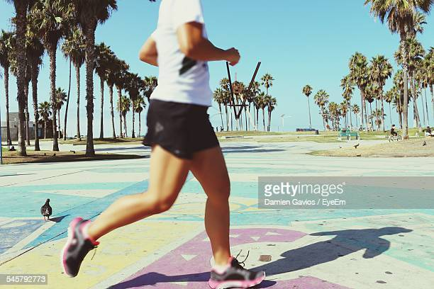 Low Section Of Woman Jogging At Venice Beach