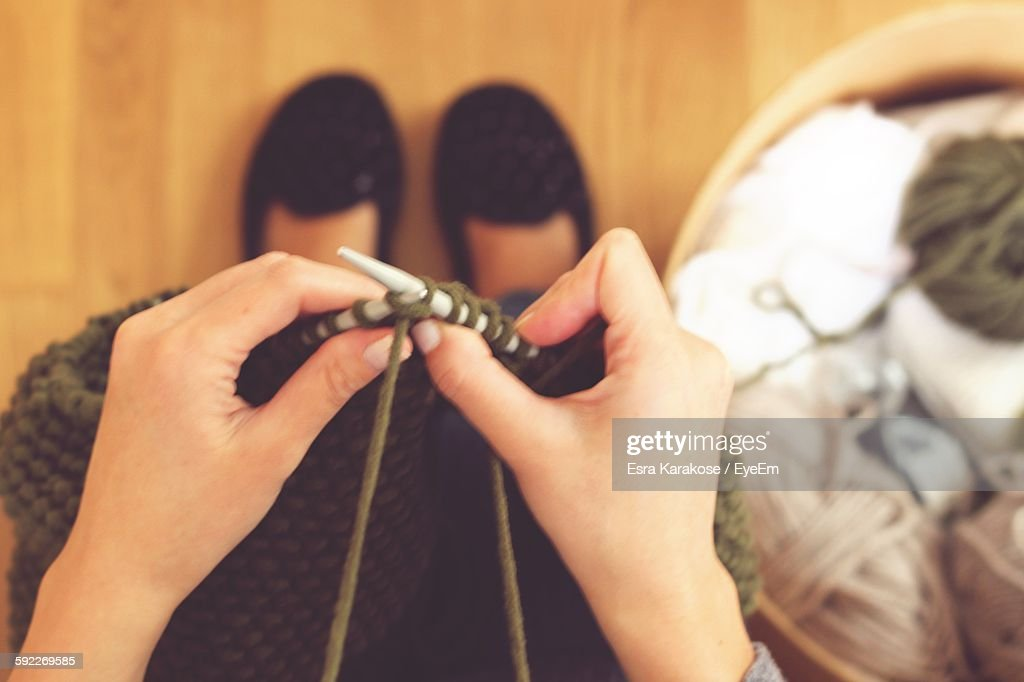Low Section Of Woman Knitting Wool : Stock Photo