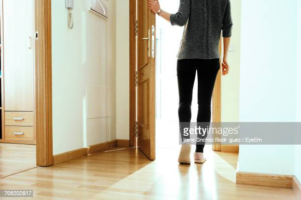 low section of woman leaving - leaving stockfoto's en -beelden