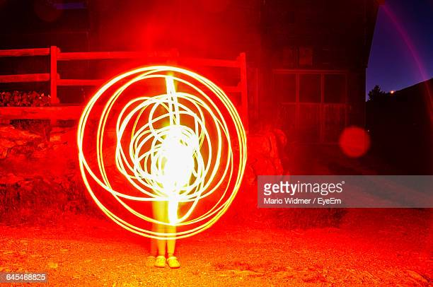 Low Section Of Woman Light Painting At Night