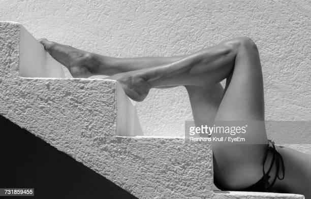 Low Section Of Woman Lying On Steps