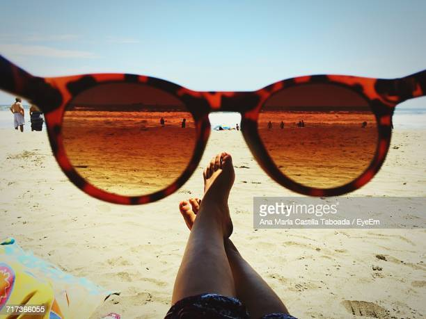 low section of woman on beach - looking through an object stock pictures, royalty-free photos & images