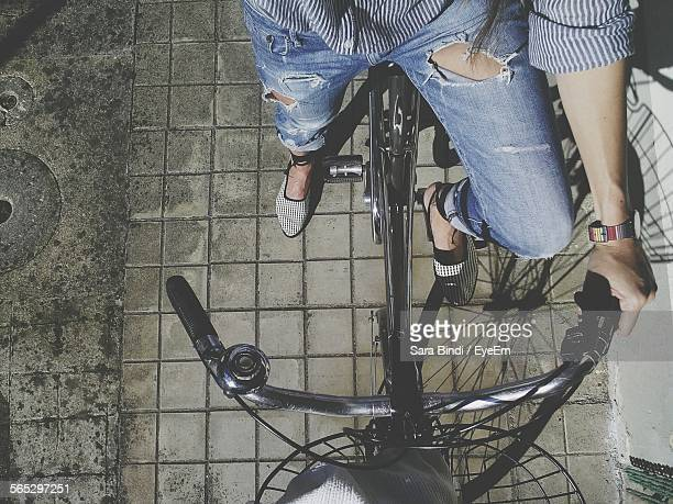 Low Section Of Woman On Bicycle