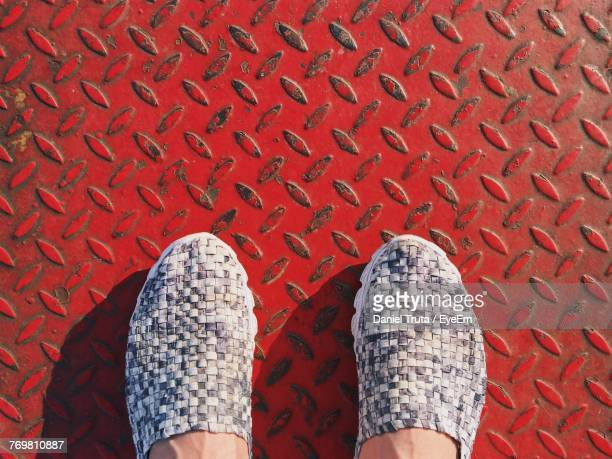 Low Section Of Woman On Red Diamond Plate