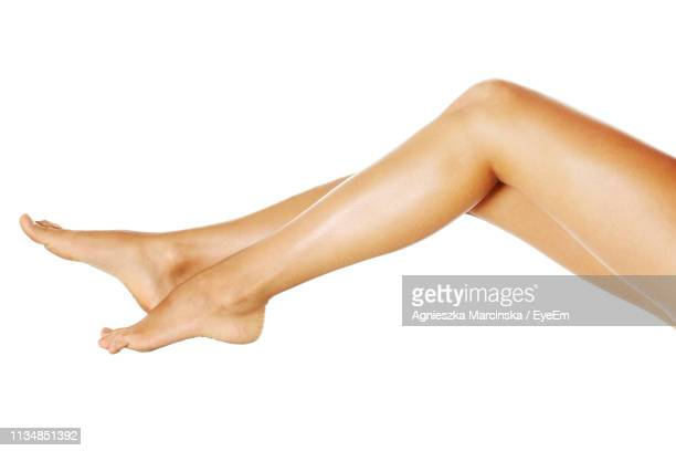 low section of woman on white background - leg stock pictures, royalty-free photos & images