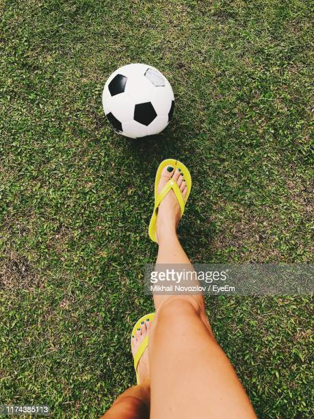 low section of woman playing soccer on field - open toe stock pictures, royalty-free photos & images