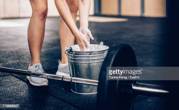 low section of woman preparing for deadlifts - weight training stock pictures, royalty-free photos & images