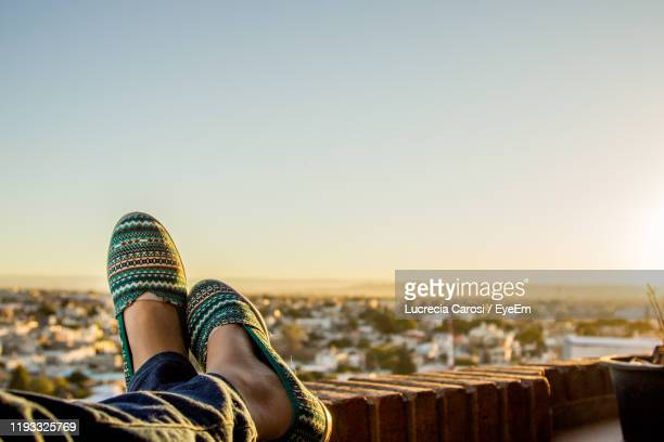 low section of woman relaxing during sunset - cordoba argentina stock pictures, royalty-free photos & images