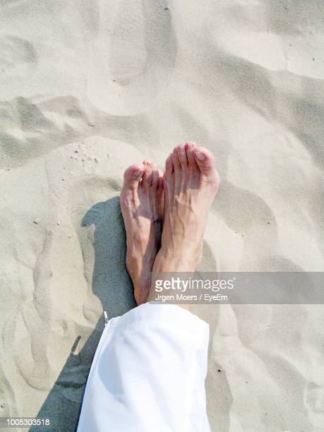 Low Section Of Woman Relaxing On Sand
