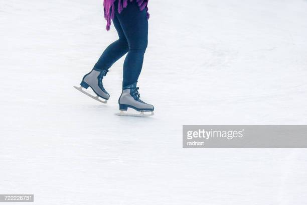 Low section of Woman skating in an ice rink