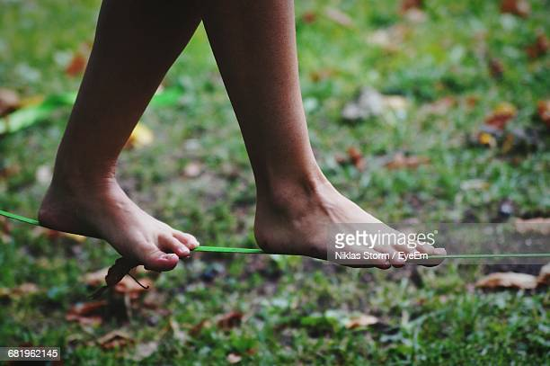 Low Section Of Woman Slacklining