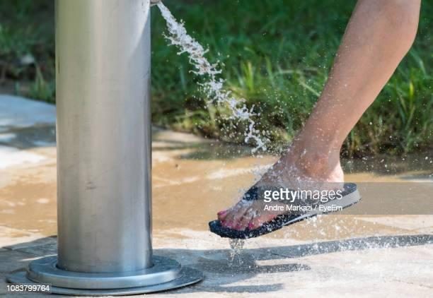Low Section Of Woman Splashing Water Outdoors