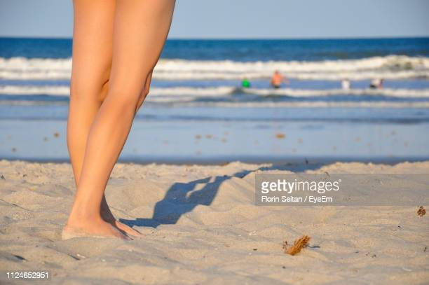 low section of woman standing at beach - florin seitan stock pictures, royalty-free photos & images
