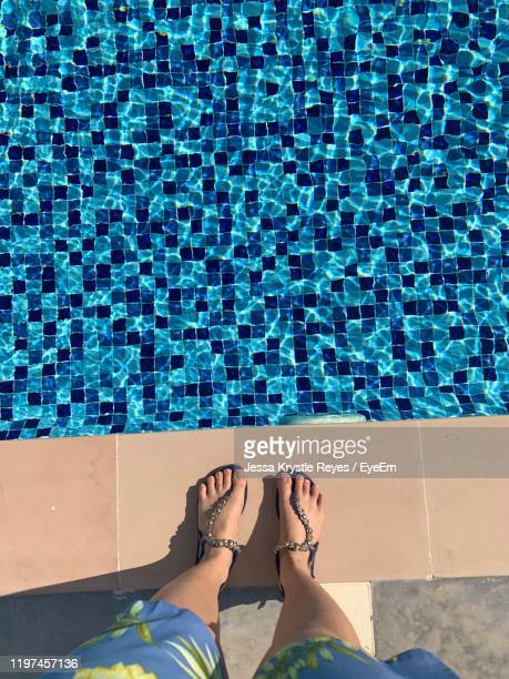 low section of woman standing by swimming pool - jessa stock pictures, royalty-free photos & images