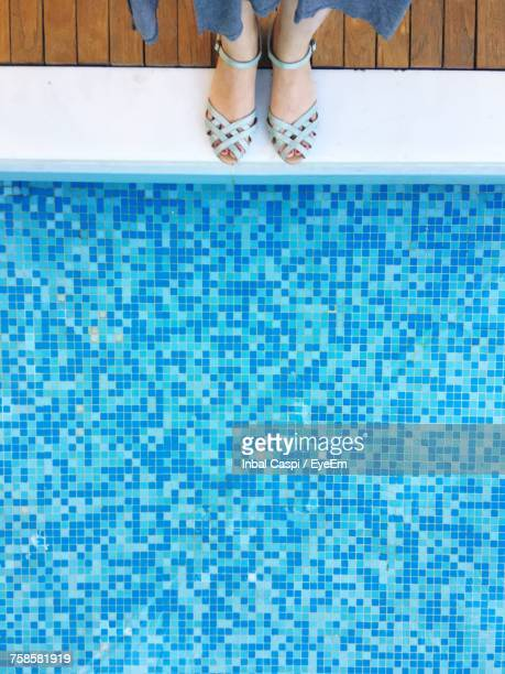 low section of woman standing by swimming pool - free mosaic patterns stock pictures, royalty-free photos & images